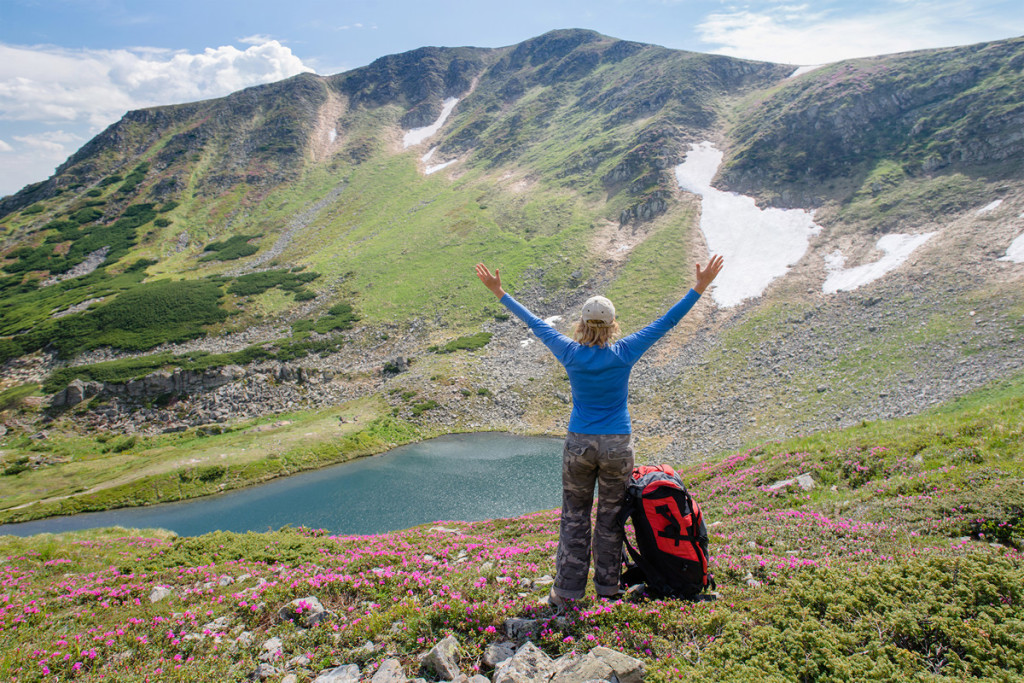 Woman enjoy beautiful view in the mountains