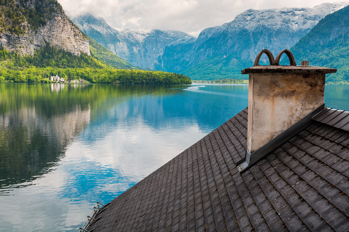 Roof and mountain lake in Hallstatt village. Tirol, Austria