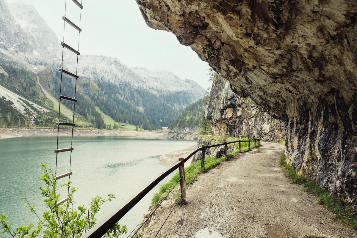 Landscape with road through the tunnel, over canyon near mountain lake Gosau, Austria