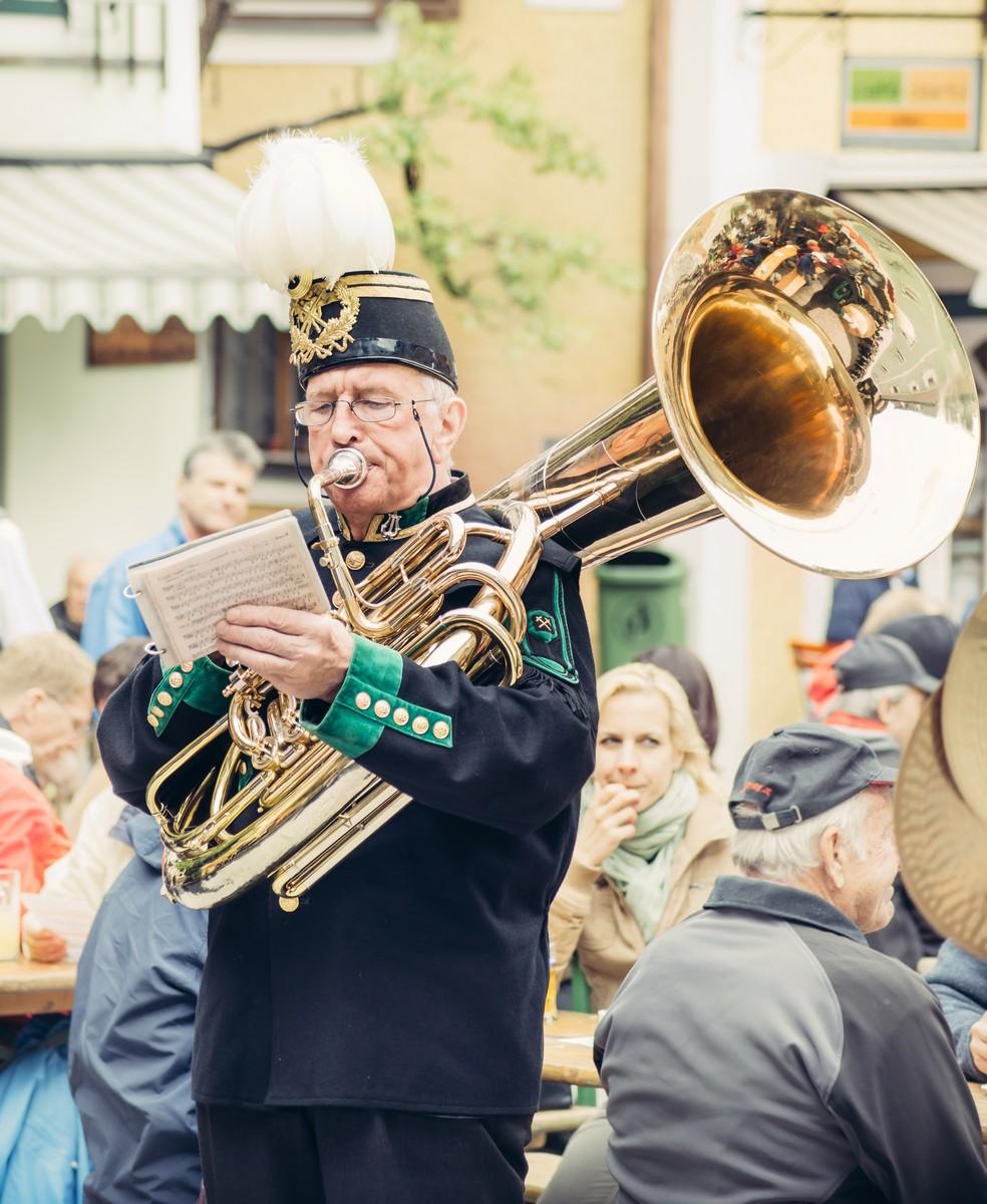 HALLSTATT, AUSTRIA - MAY 03, 2014: Musician from the local orchestra during the street festival on the main square in Hallstatt village, Austria (UNESCO World Heritage region)
