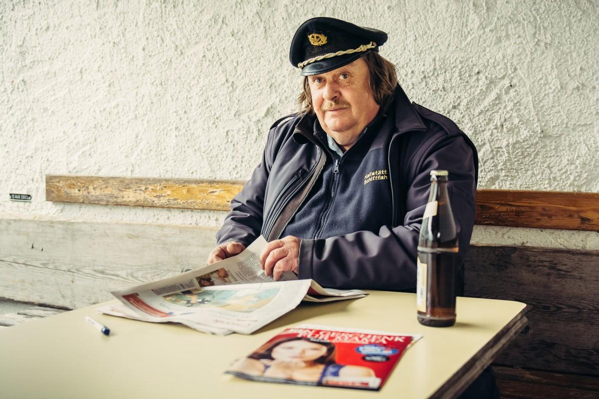 HALLSTATT, AUSTRIA - MAY 03, 2014: Captain of the ferry on mountain lake Hallstatt during the break in Alps