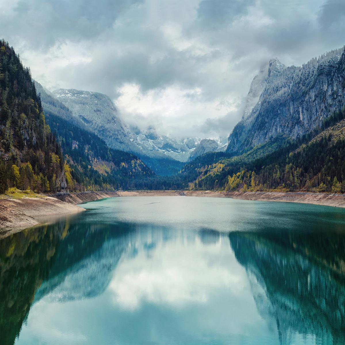 Alpine lake with dramatic sky and mountains. UNESCO heritage site. Gosausee, Tirol, Austria