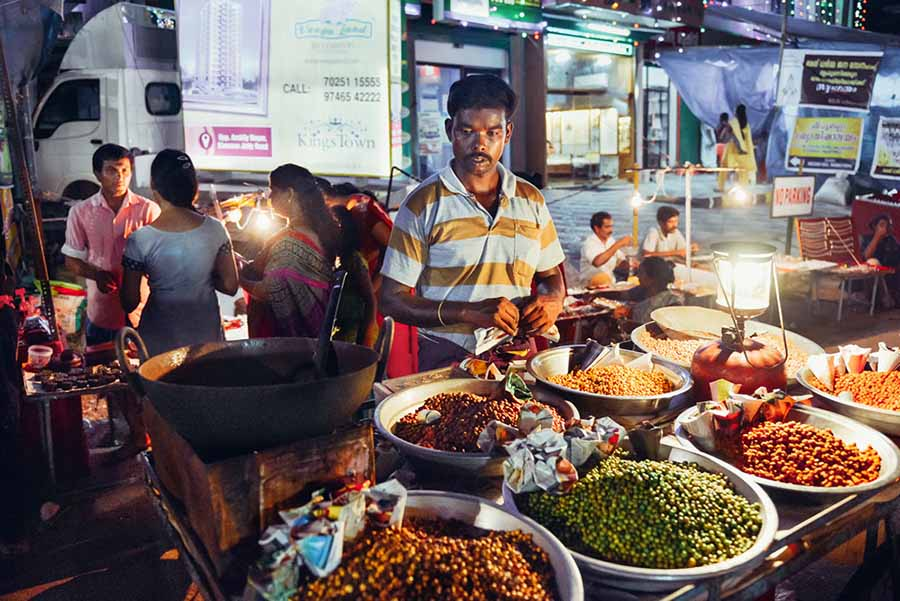 Man sells classical Indian street food in Kochi, Kerala, India - December 10, 2015